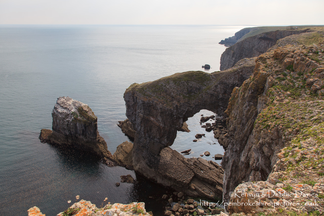 The Green Bridge of Wales is one of the most famous landmarks in Wales, and one of the most spectacular sites on the Pembrokeshire Coast. It is located close to Castlemartin in the south of the county, and is adjacent to the Stack Rocks and the Cauldron.