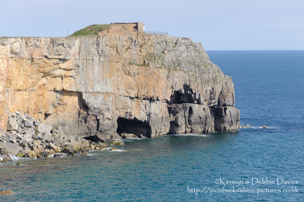 Cliffs at St Govan's Head with the Coastguard Lookout in the background.