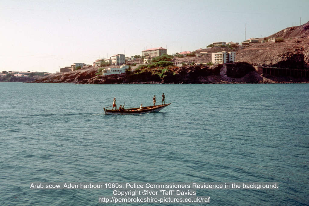 Arab scow, Aden harbour 1960s. Police Commissioners Residence in the background.