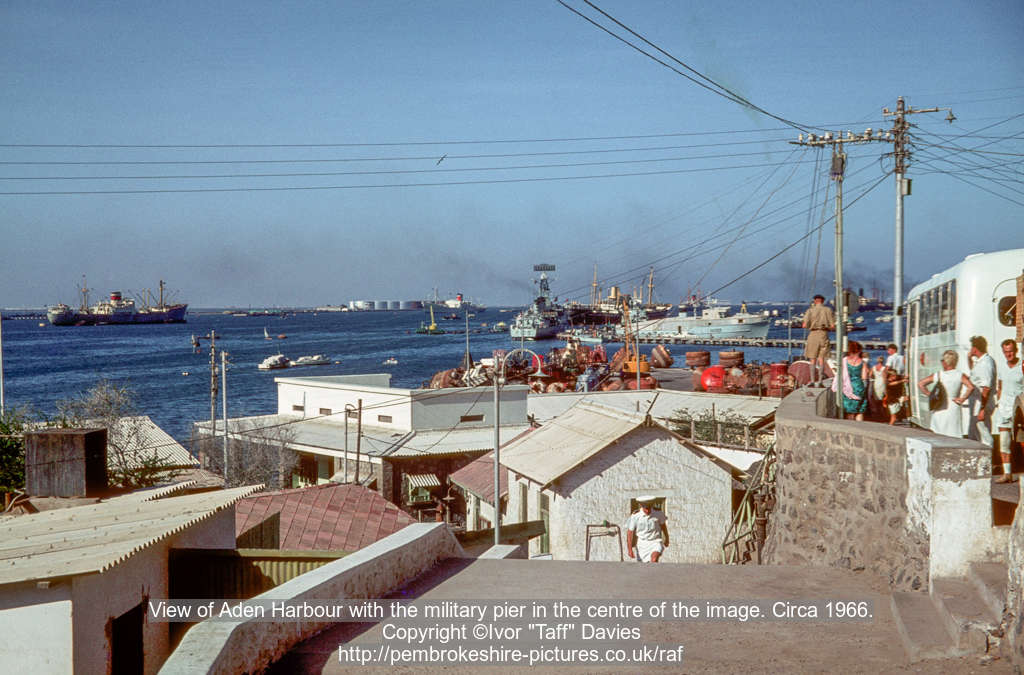 View of Aden Harbour with the military pier in the centre of the image. Circa 1966.