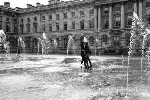 Couple in the fountains at Somerset House, London