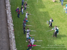 Learning to sword fight at Pembroke Castle, Pembrokeshire