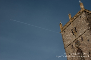 A plane passes over the 125ft high central tower of St Davids cathedral